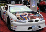 2-player Full Size NASCAR Simulator  (Grand Prix)   with client's logo or custom graphics